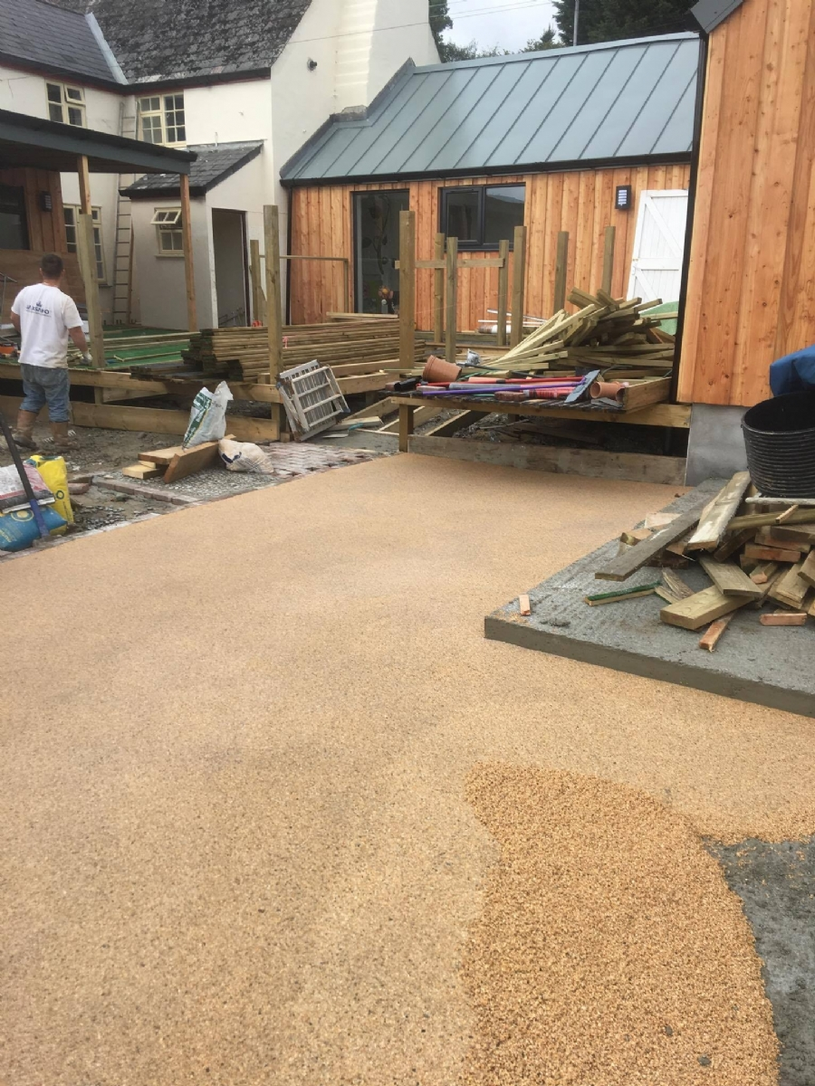 Laying resin bound gravel on a building site