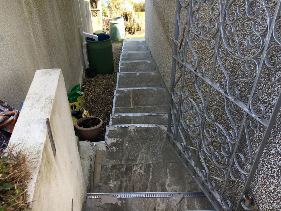 Making a safe surface for steep garden steps