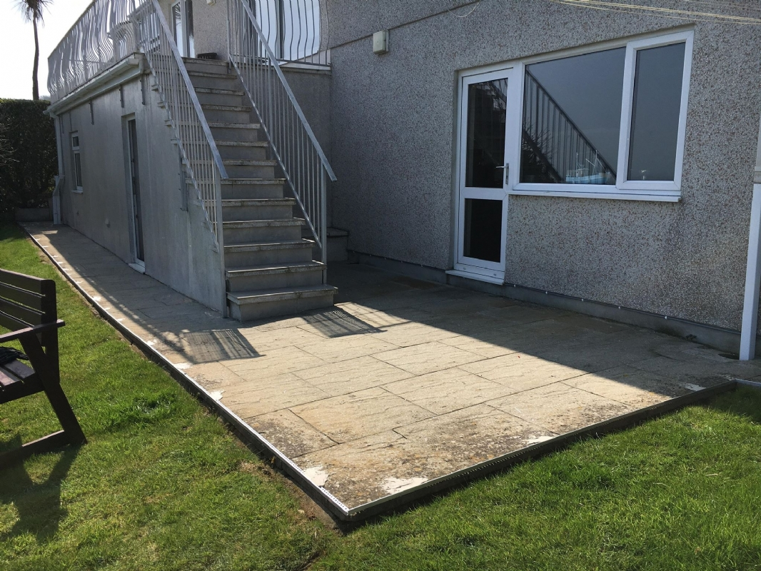 Oltco Resin Bound Gravel Driveway Specialists create a new patio