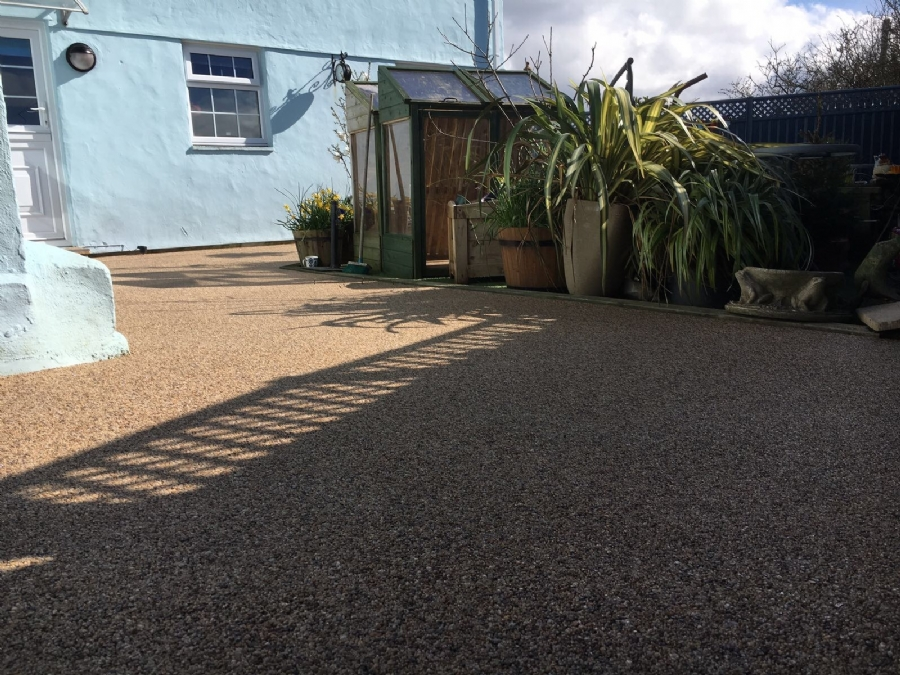 Resin bound transformation of hot tub area.